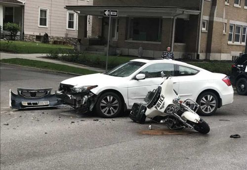 KCK motorcycle officer suffers minor injuries in crash with car