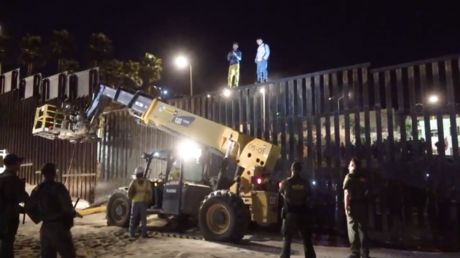 'We won't let them run us over!' Growing migrant crowd tests US-Mexico border fortifications