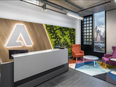 PHOTOS: Adobe has moved into a colourful new London office with a 150m rooftop running track