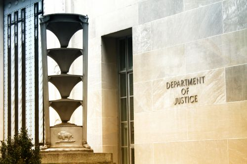 Justice Department charges five Chinese nationals with hacking over 100 companies