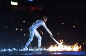 Freeman lights up Sydney Olympics to kick off new millennium