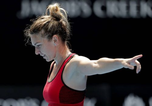 Top-ranked Halep fends off Davis in marathon match