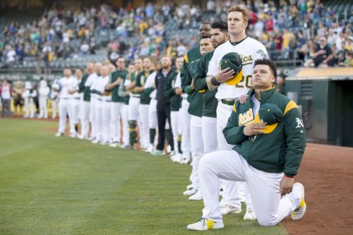 A's catcher Maxwell no longer will knell for national anthem