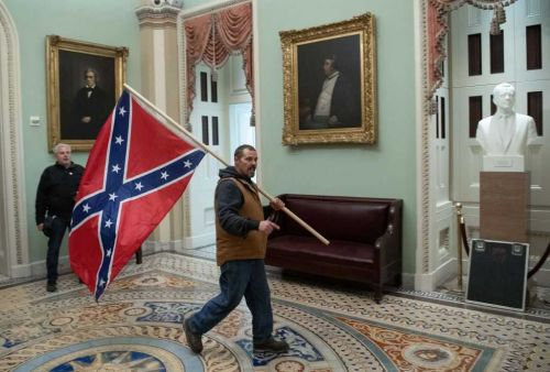 Pro-Trump rioter who carried Confederate flag through U.S. Capitol arrested: report