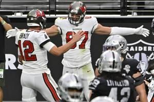 Brady's 4 TD passes lead Bucs past Raiders 45-20