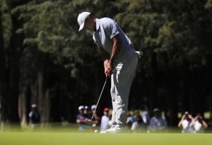 McIlroy opens with 63 has Woods struggles in Mexico debut