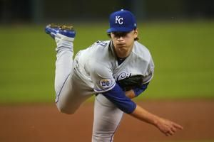 Singer, Royals shut out Tigers with two-hitter