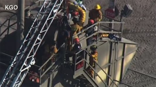 LIVE: Crew trying to rescue person stuck in cement mixer