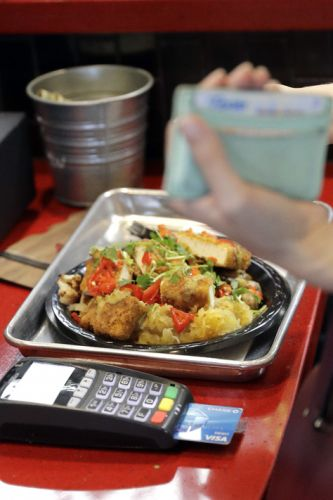 Cashless restaurants are spreading despite some qualms about exclusion
