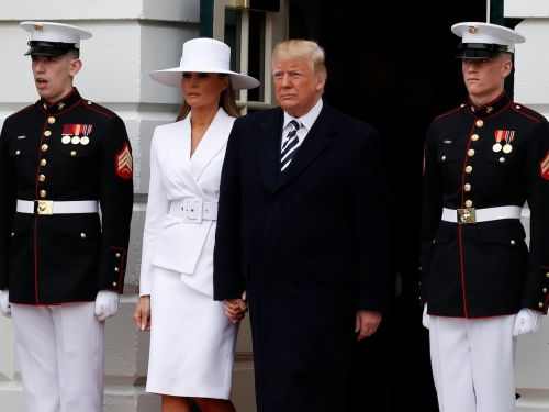 Melania Trump wore a huge white hat for the French president's arrival ceremony - and people are freaking out and comparing her to Beyoncé