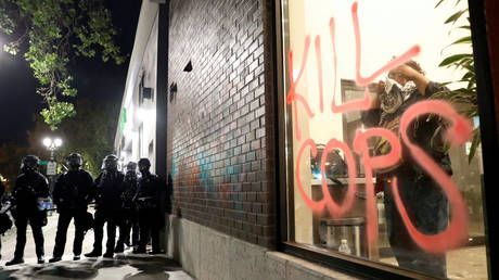 Officer dies from injuries after being shot during Oakland protests - Police statement