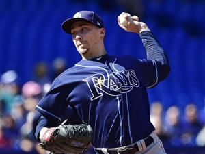 Snell wins 21st, 9th in row, as Rays beat Blue Jays 5-2