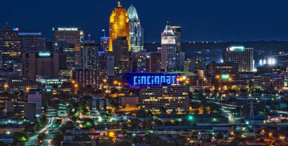 PHOTOS: Cincinnati buildings light up blue in support of frontline workers amid COVID-19