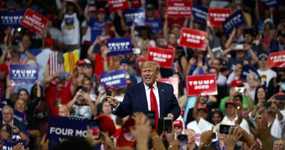 Man arrested for slapping reporter's hand at Trump's rally