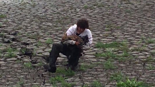 Man wades through 100 yards of sewer sludge to rescue tired fawn