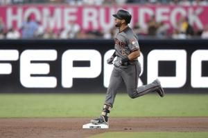 Buchholz pitches four-hitter, Diamondbacks beat Padres 5-1