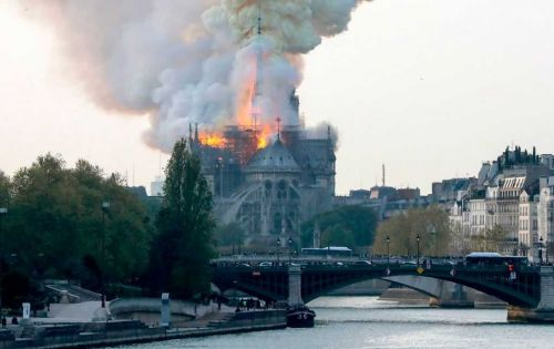 Notre Dame fire: Paris fire department says cathedral blaze is quickly spreading
