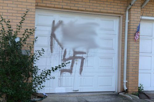 Jewish family's house defaced with swastika, racial slur