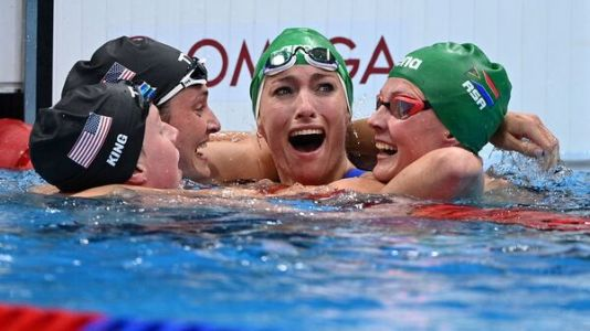 See These Swimmers Share A Sweet Hug After South Africa Takes Gold And A World Record