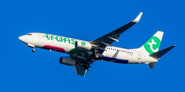 A budget flight from Paris to Morocco was forced to land after a passenger tried to open the emergency exit in midair