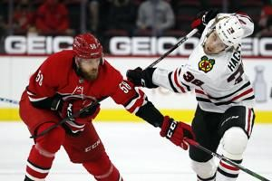 Chicago Blackhawks lose 6-3 to the Carolina Hurricanes, with Kirby Dach a late scratch after his wrist problems resurface