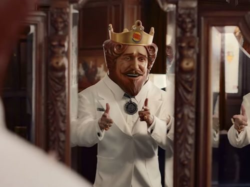 Burger King takes a direct shot at KFC in a new ad that dresses the King up in Colonel Sanders' clothing
