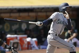Dee Gordon homers in 12th, Mariners beat A's 2-0