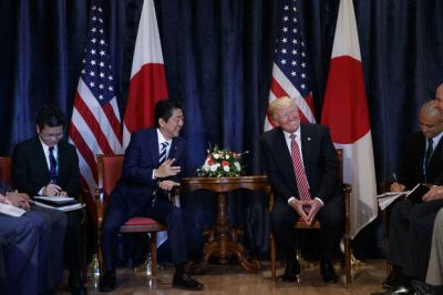 The Latest: Trump, Abe agree to boost North Korea sanctions
