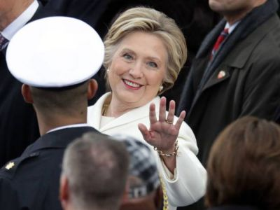 Dressed in white, Hillary Clinton arrives at inauguration to honour 'enduring values' of democracy