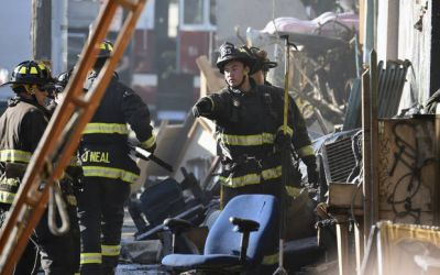 The Latest: Crews recover more bodies from burned building