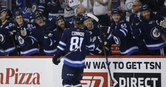 Connor's hat trick helps Jets top Preds, clinch playoff spot
