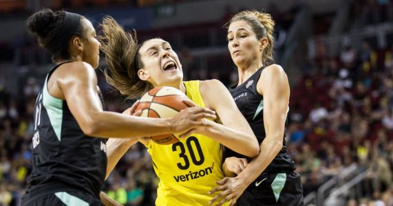 Storm rains down threes to clinch top seed in WNBA by beating Liberty
