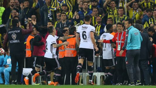 Besiktas boss injured as Fenerbahce cup clash abandoned amid chaotic scenes