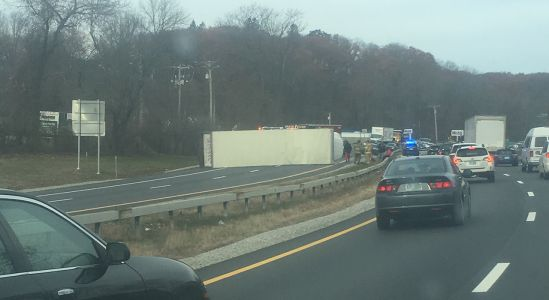 I-293 South closed at Exit 6 after tractor-trailer rolls over