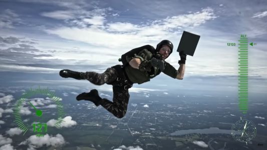 Microsoft thanked a veteran for his service by having an Xbox One X with 'Battlefield V' delivered to him by a skydiver - here's the video of the jump
