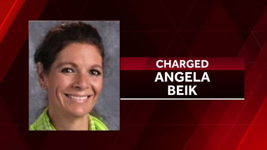 Former eastern Iowa school nurse now faces assault charge
