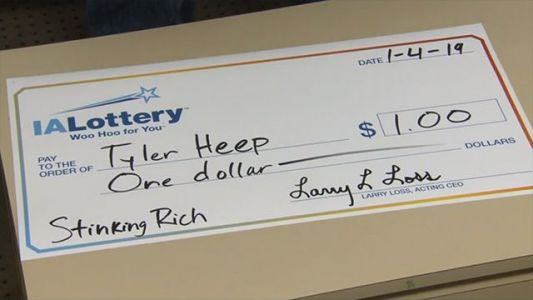 Man wins $1 in lottery, gets millionaire photo shoot treatment