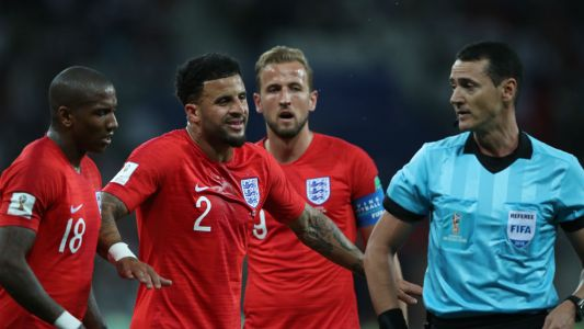 Who is Wilmar Roldan, the referee in charge of the Tunisia vs England game?