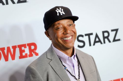 Russell Simmons lays low in press section at 'Power' party