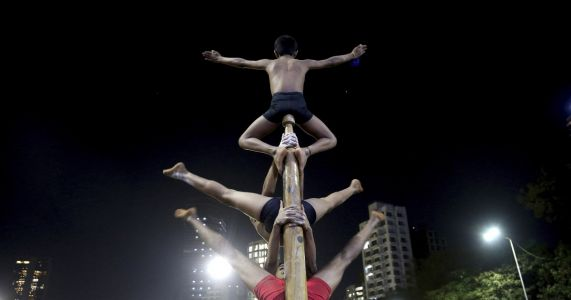 AP Photos: Centuries-old Indian pole wrestling goes global