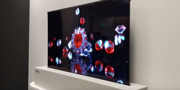 The futuristic LG TV that rolls itself in and out of a box could hit living rooms in 2019 - check it out in action