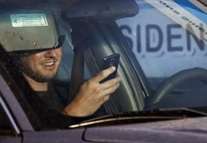 Arizona outlaws hand-held phone use while driving