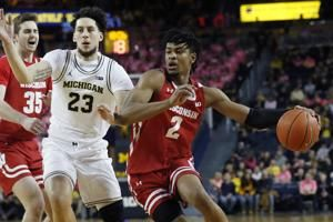 Trice, Wisconsin hold off No. 19 Michigan 81-74