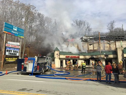 Crews battle fire at North Huntington strip mall