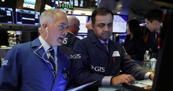Stock trading is muted as investors wait for Fed statement