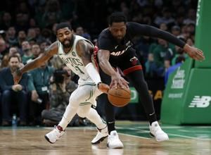Irving's 26 points, 10 assists carries Celtics past Heat