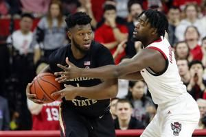 Walker helps No. 8 Florida State beat NC State 67-61