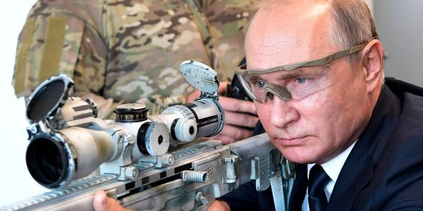 Putin fired a Kalashnikov sniper rifle at a Moscow shooting range, and Russian TV claims he hit the target 'more than half the time'