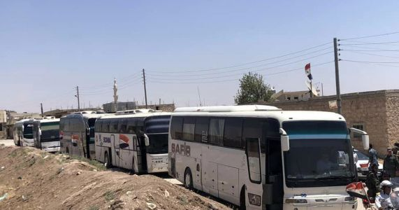 In Syria, evacuation underway of pro-government villages