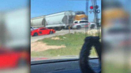 Deputy survives after SUV hit by train